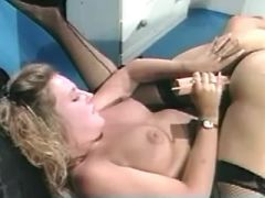 Blonde lesbian dildoing juicy pussy of brunette
