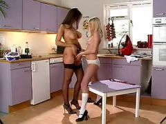 Mature lesbian spoils innocent babe on kitchen