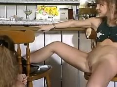 Lusty lesbians get deep fistfuck and dildo in bar