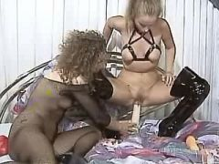 Blonde slutty in high boots fistfucked by lesbian