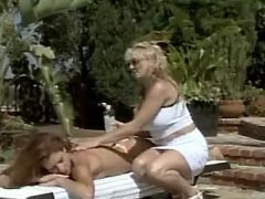 Mature lesbian spoils cute innocent chick by pool