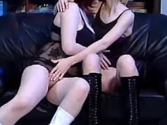 Lesbian dildofucks cute girlfriend in high boots