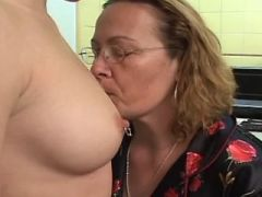 Lusty granny spoils innocent chick on kitchen